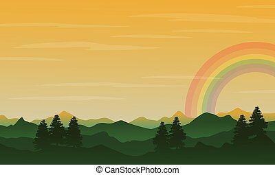 Silhouette of hill with rainbow landscape