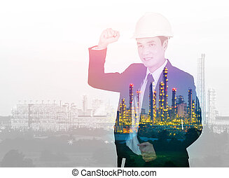 Double exposure of engineer celebrating with arm raised...