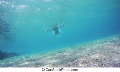 Young Man Free Dives Snorkeling and Floating Through the...