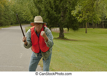 old man with a cane out walking