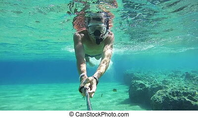 Young Man Snorkeling on Colorful Reef in Red Sea, Egypt. Man...