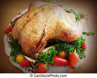 Roasted whole chicken on a plate