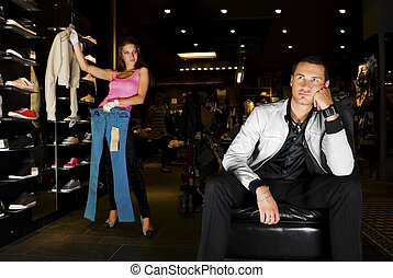 Infinity shopping - Pair of young adults trying on new...