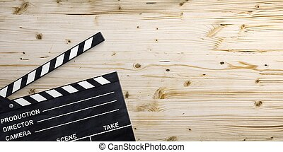 Movie clapper on wooden surface. 3d illustration - Movie...