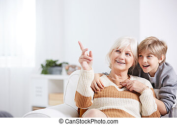 Grandson and grandmother - Positive grandmother spending...