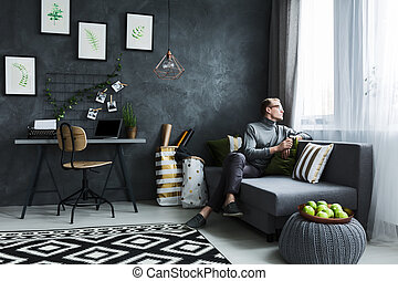 Hipster sitting on a couch