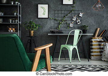 Apartment with home office area and cozy armchair