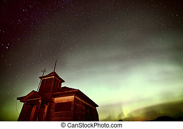 Northern Lights behind old abandoned church or shool house