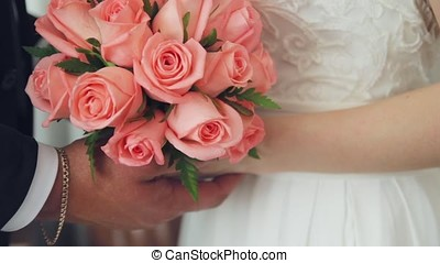 bride with a bouquet in hand 1