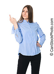 Smiling young woman in a striped shirt is pointing her...
