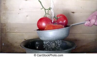 Wash tomatoes in colander slow motion