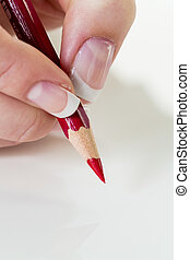 hand with red pencil - a hand holding a red pen. symbol...