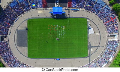 Aerial survey Football stadium - Religious service. A flight...