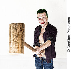 guy with crazy joker face, green hair and idiotic smile....