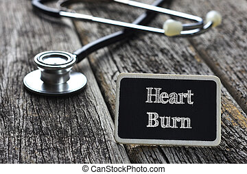 Medical Concept- Heart Burn word written on blackboard with...