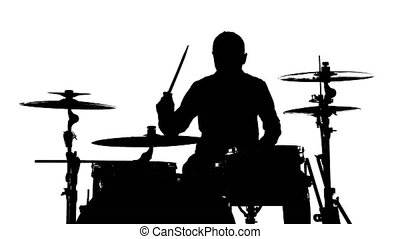 Silhouette of the drummer and drums - Silhouette of drummer...