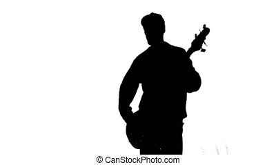 Silhouette of musician with bass guitar - Silhouette of a...