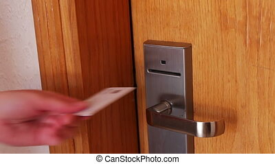 woman opens the door with the key card - Woman puts the key...