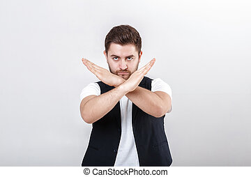 young handsome man with beard in white shirt and black...