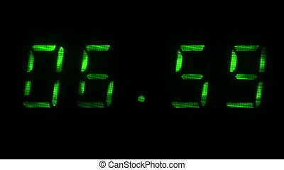 Digital clock shows time of 06 hours 59 minutes to 07 hours...