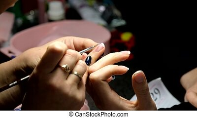 Manicure master works with client - Manicure master works...