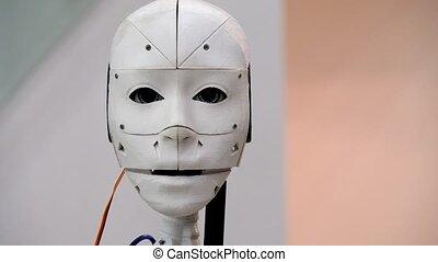 robot moves its head - The robot moves its head