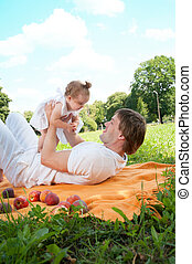 Young happy father with daughter in the park
