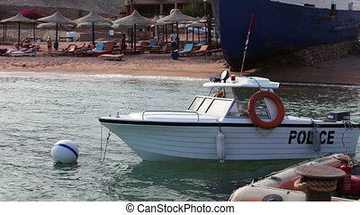 Boat water police moored near the shore in Red Sea - Boat...