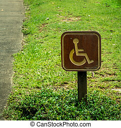 Wooden handicapped sign