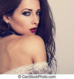 Beautiful expressive make-up model posing with vinous color...