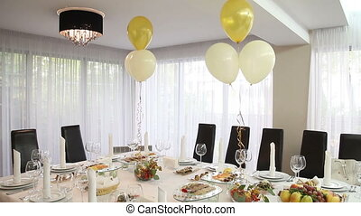 laid banquet restaurant table with ballons