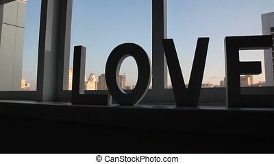 Decor word LOVE on window at home