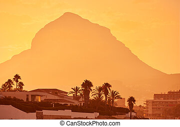 Javea Xabia sunset with Montgo mountain in Alicante at Spain