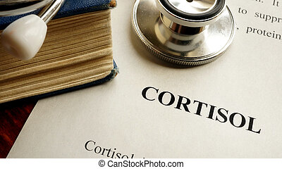Title Cortisol written on a page. Hormones concept.