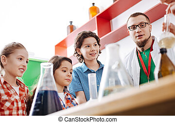 Delighted curious kids observing an experiment