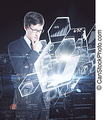 Businessman using laptop with charts - Businessman using...