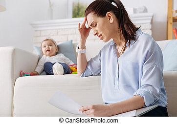 Hardworking young mother suffering from exhaustion - How can...