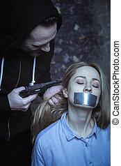 Violent abductor torturing his hostage for information -...