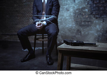 Desperate business executive locked up in a dark place - Is...