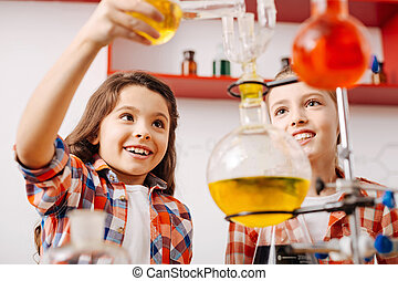 Positive curious girls experimenting - Chemistry club....