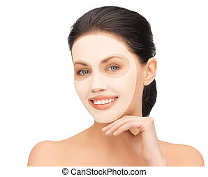 beautiful young woman with collagen facial mask
