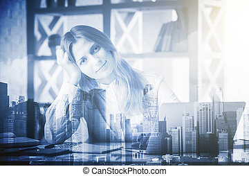 Job concept - Attractive young female sitting at workplace...