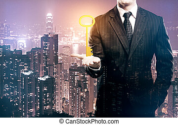 Accessibility concept - Businessman holding ornate golden...