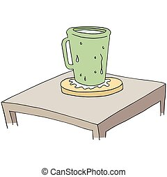 coaster protecting table from moisture - An image of a...