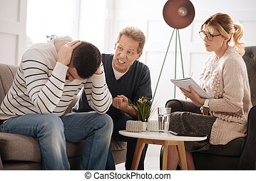 Cheerless unhappy man not willing to listen - Conflict in...