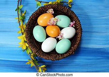 Easter Eggs Decoration - Easter Eggs in a basket with spring...
