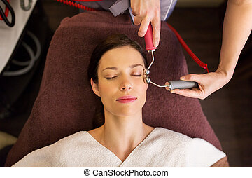 woman having hydradermie facial treatment in spa - people,...
