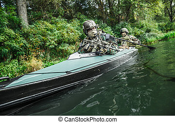 Militants in army kayak - Special forces men with painted...