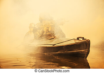 Militants in army kayak - Special forces marine operators in...