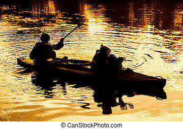 Militants in army kayak - Silhouette of special forces men...